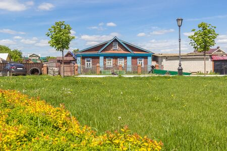 Village house and green meadow in front of it, Sviyazhsk, Russia Фото со стока