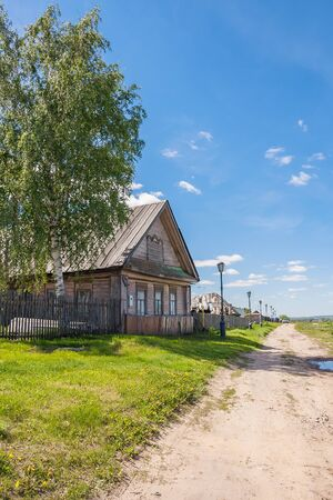 House with a birch in a village in summer