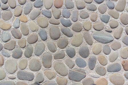 Gray  of cobblestone pavement Фото со стока