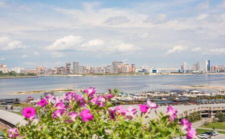 Kazan city, Republic of Tatarstan/Russia - may 23 2019: View of the bank of Kazanka through flowers
