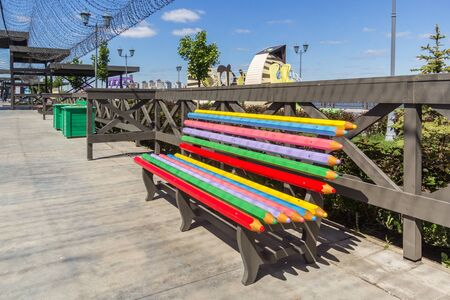 Kazan city, Republic of Tatarstan/Russia - may 24 2019: Colored bench on the embankment