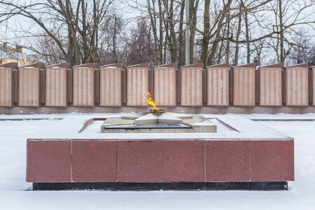 Balahna city, Nizhny Novgorod region/Russia - january 05 2020: Eternal flame on the background of lists of soldiers