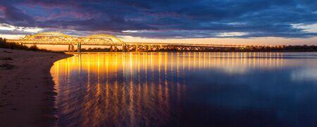 Panorama of the illuminated bridge across the Volga in Nizhny Novgorod, Russia Фото со стока