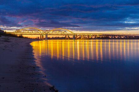 Bridge with reflection in the Volga river in Nizhny Novgorod, Russia Фото со стока