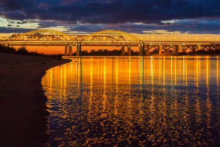 The bridge over the Volga River in Nizhny Novgorod in the evening illumination Фото со стока