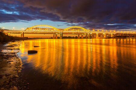 Golden illumination of the bridge across the Volga in Nizhny Novgorod