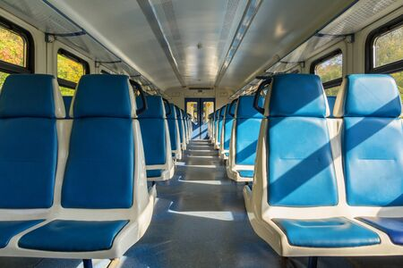 Blue seats in an electric train carriage without passengers in Russia