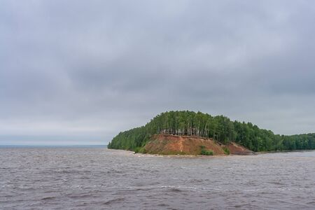 Storm in a reservoir near the peninsula on the Volga River at summer Фото со стока