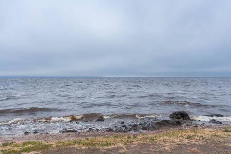 Storm at sea, river reservoir at summer