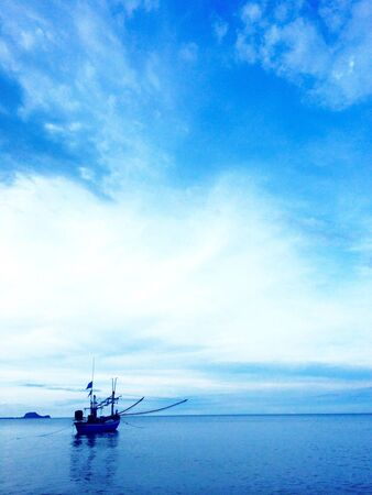 view: Fishing boat in the sea Stock Photo