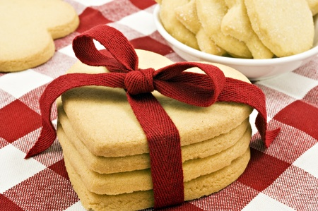 Heart shaped cookies with red ribbon on cloth photo