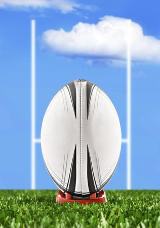 Rugby ball ready to be kicked over the goal posts photo