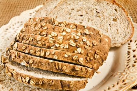 Healthy whole wheat bread in slices - close up photo