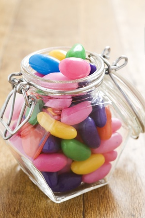 Colorful jelly beans in a bottle - very shallow depth of field Standard-Bild