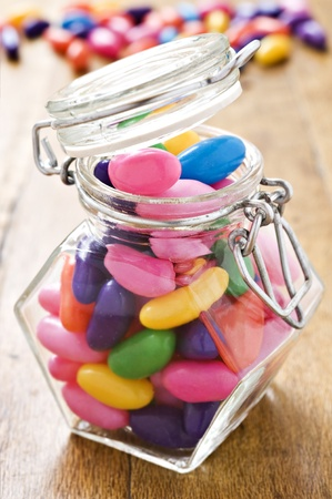 Colorful jelly beans in a bottle - very shallow depth of field 版權商用圖片