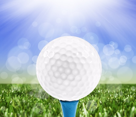 Spring background with a golf ball on a peg photo