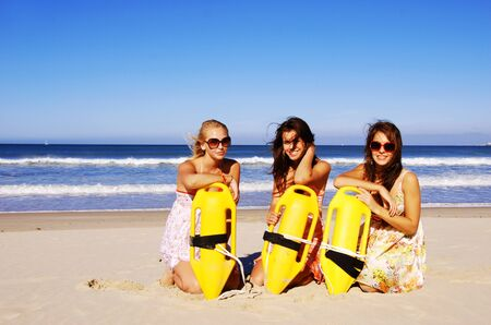 Three young woman having fun on the beach on a summer day Stock Photo - 9431417