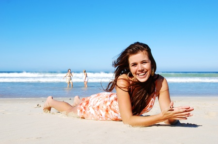 Young woman enjoying summer on the beach
