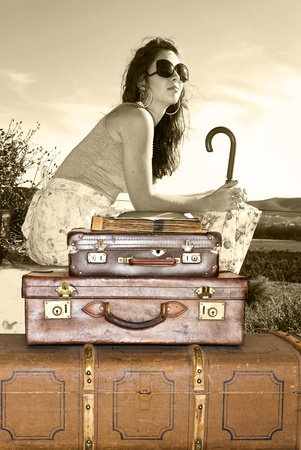 Young woman traveling with her suitcases photo