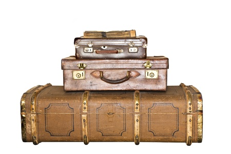 Three old suitcases on white