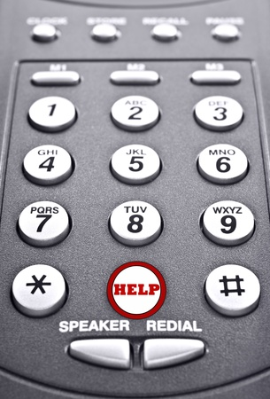 Keypad of a telephone with a red button for help photo