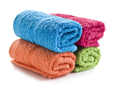 Fresh rolled up towels on a white background