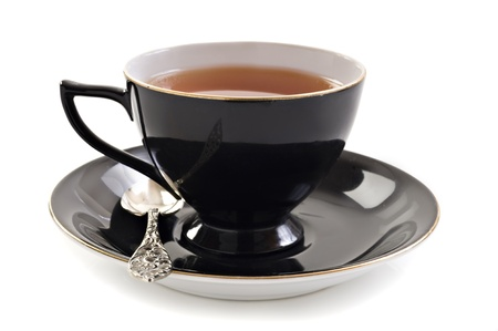 Black tea cup on a white background with space for text photo