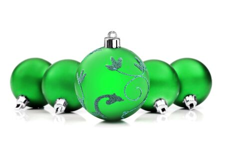 Green christmas baubles on white background with space for text Stock Photo - 10535255