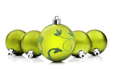 lime green background: Green christmas baubles on white background with space for text Stock Photo