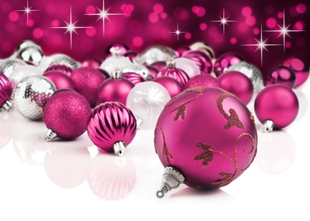 Pink decorative christmas ornaments with star background