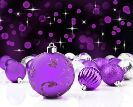 Purple decorative christmas ornaments with star background