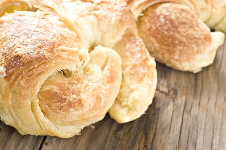 Close up of freshly baked croissants on a wooden surface photo
