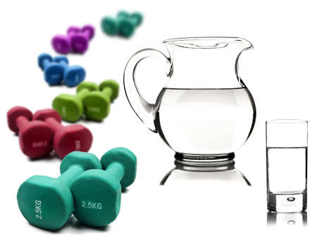 jug: Healthy lifestyle - water in a pitcher and glass with dumbbells