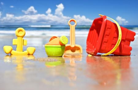 Closeup of childrens beach toys at the beach