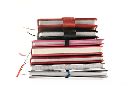 Close up of stacked up books on a white background with space for text Stock Photo - 14311452