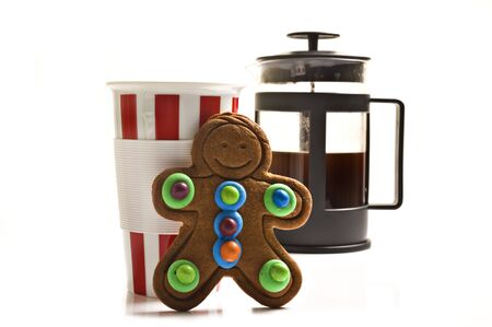 Colorful gingerbread man with a cup and plunger of coffee photo