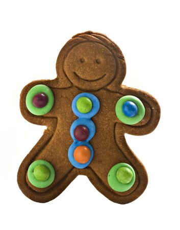 Colorful gingerbread man on white background with space for text photo