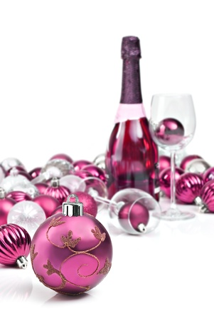 Pink christmas ornaments with wine