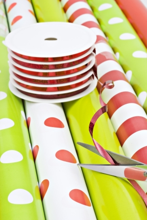 paper curl: Rolls of gift wrapping paper and rolls of ribbon