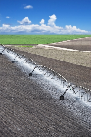Farm field with modern irrigation system water a newly planted field Stock Photo