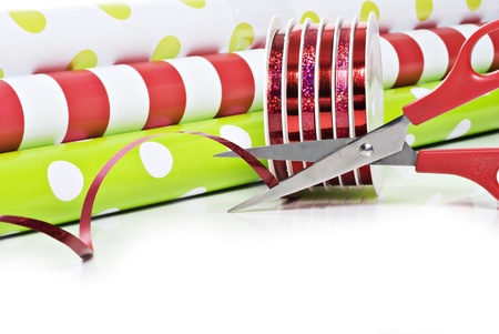 Rolls of gift wrapping paper and rolls of ribbon