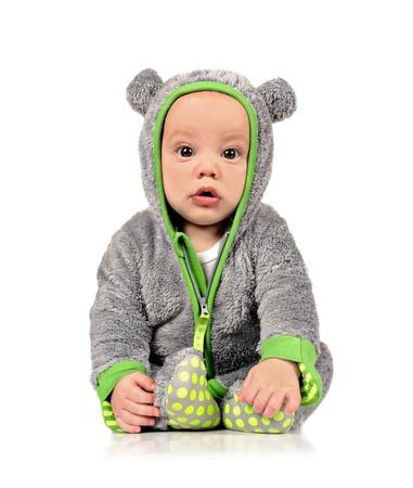 Cute little baby boy in fun clothes on white background Standard-Bild