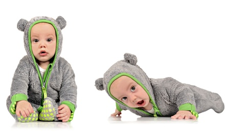 Six month old twin brothers on a white background