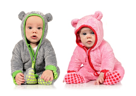 pediatrics: Six month old twin brother and sister on white background