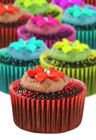 cake decorating: Colorful cupcakes in different color cups Stock Photo