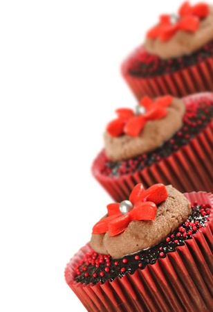 Delicious chocolate cupcakes in red photo