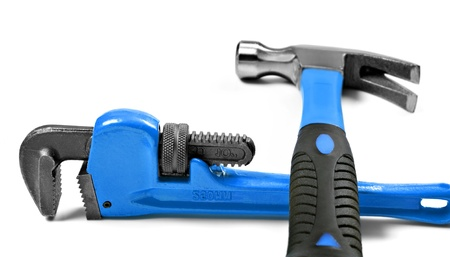 New hammer and wrench on a pure white background with space for text photo
