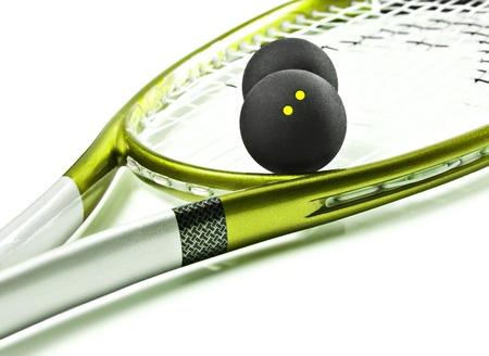 racquetball: Verde y plata raqueta de squash y bolas Foto de archivo