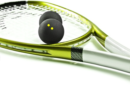 Green and silver squash racket and ball on a white background with space for text photo