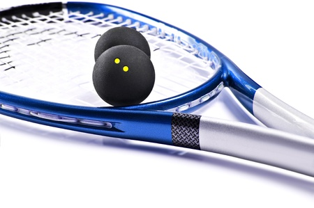 Blue and silver squash racket and ball on a white background with space for text photo